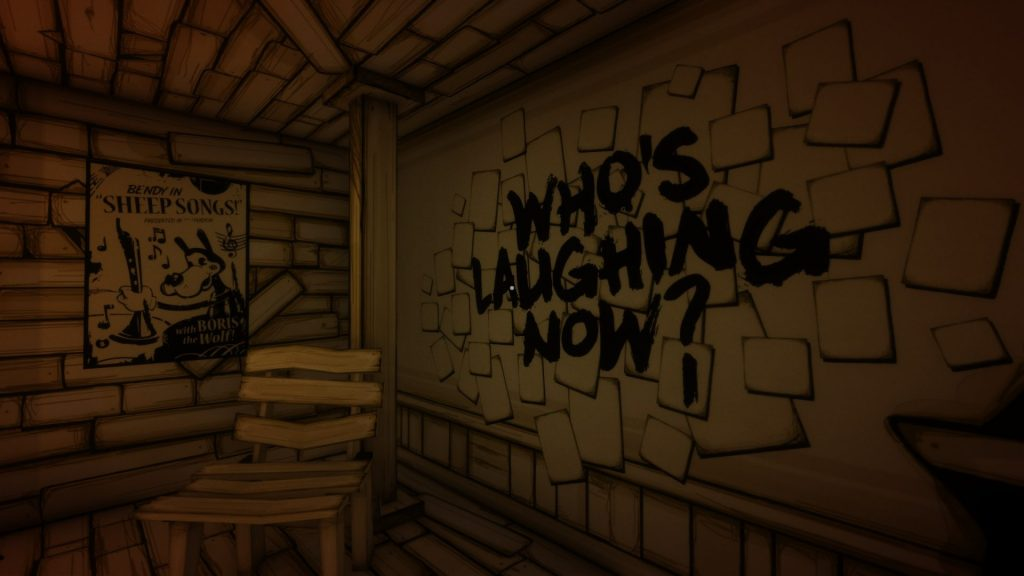 "The words ""Who's Laughing Now?"" have been painted in rough black letters on the wall"